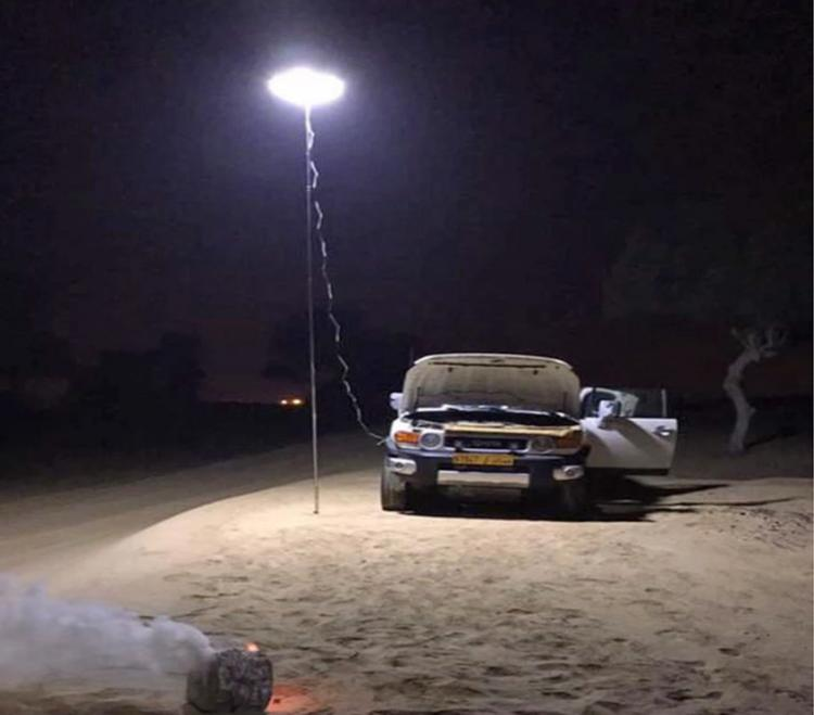 This Giant Telescoping Outdoor Lamp Attaches To Car Battery, Perfect For Night Games, Emergencies