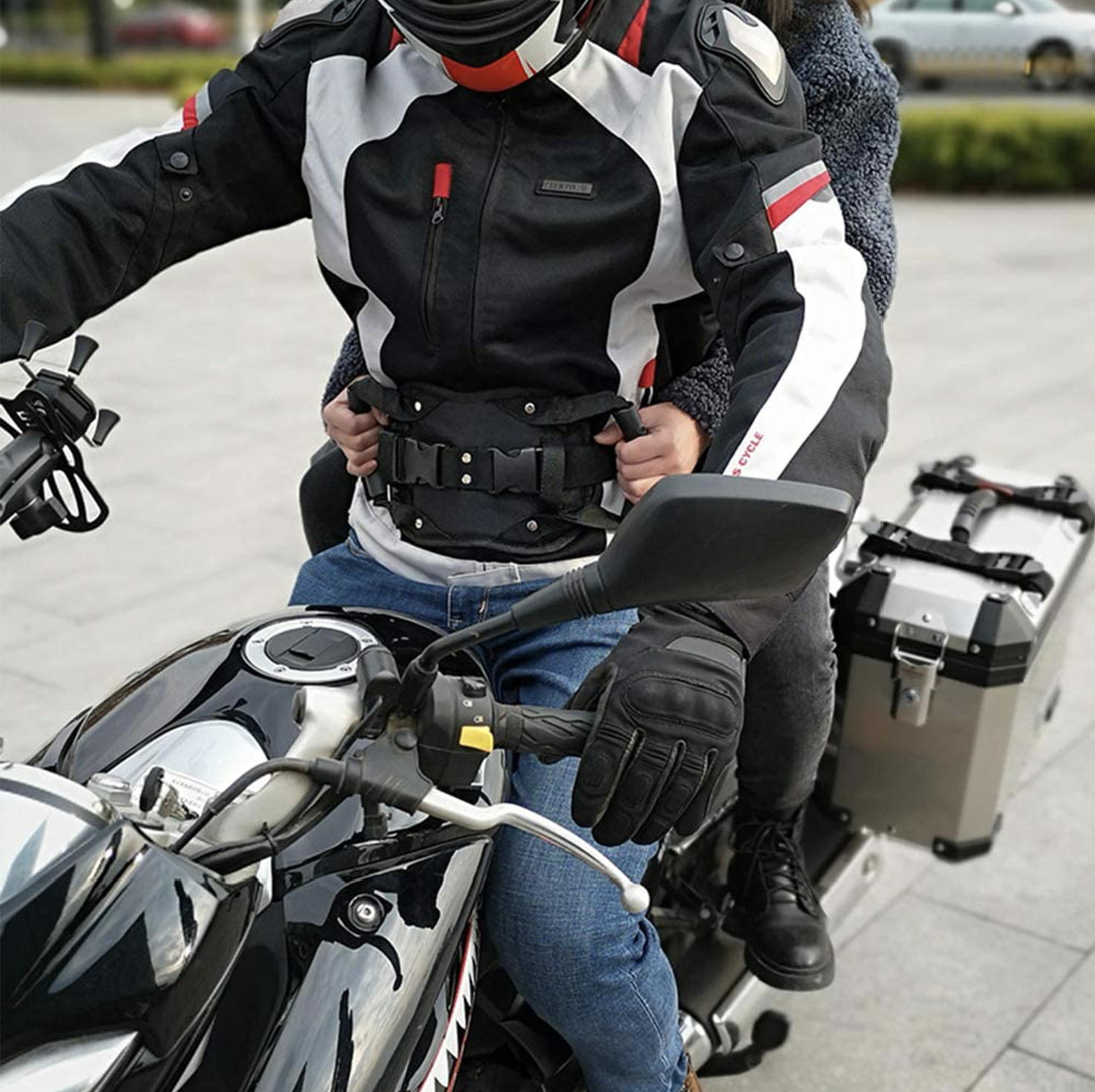 THE MOTORCYCLE PASSENGER SAFETY BELT SYSTEM