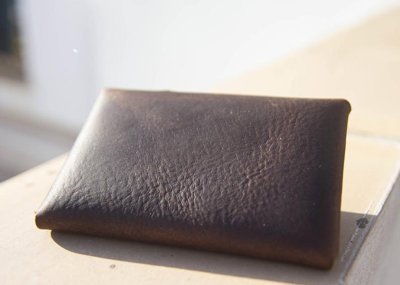 Beautiful Kodiak Oiled Leather Credit Card Wallet made from Premium pull up leather with a Solid Brass Sam Browne Button and Washer Closure        Update your settings