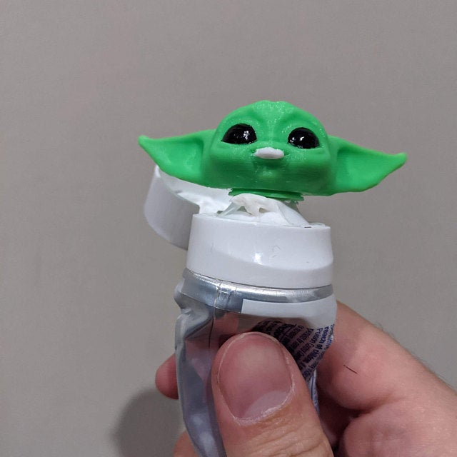 Cute Baby Yoda toothpaste topper.